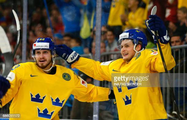 Sweden's Oliver Ekman-Larsson and William Nylander celebrate a goal during the IIHF Men's World Championship Ice Hockey semi-final match between...