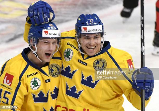 Sweden's Oscar Moeller and Paer Lindholm celebrate Lindholm's 0-2 third period goal during the match between Canada and Sweden at the Karjala...