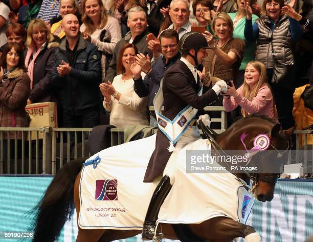 Sweden's Patrik Kittel riding Delaunay Old hands a young audience member a rosette after winning the FEI World Cup Dressage Grand Prix Freestyle...