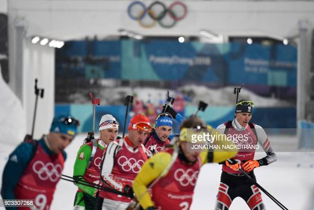 TOPSHOT Sweden's Peppe Femling arrives at the shooting range in the men's 4x75km biathlon event during the Pyeongchang 2018 Winter Olympic Games on...