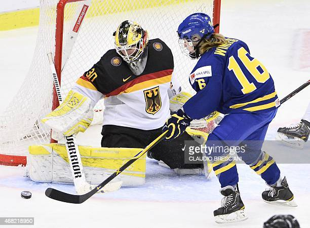 Sweden's Pernilla Winberg tries to score against Germany's goalkeeper Jennifer Harss during the IIHF Ice Hockey Women's World Championship group B...