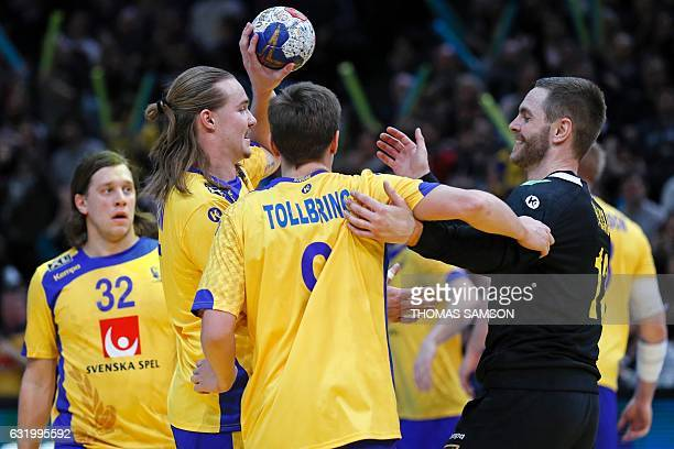 Sweden's pivot Andreas Nilsson Sweden's left wing Jerry Tollbring and Sweden's goalkeeper Andreas Palicka celebrate winning the 25th IHF Men's World...