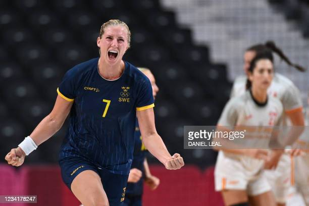 Sweden's pivot Linn Blohm celebrates after scoring during the women's preliminary round group B handball match between Spain vs Sweden of the Tokyo...