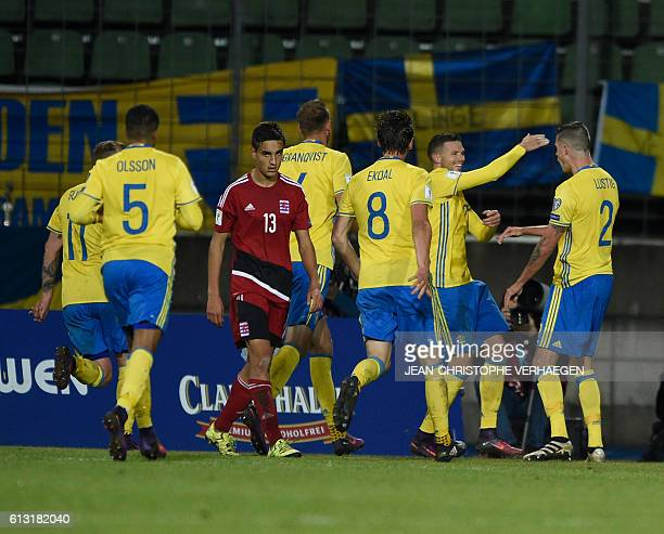 Sweden's players celebrate after scoring during the FIFA World Cup 2018 football qualification match between Luxembourg and Sweden at Josy Barthel...