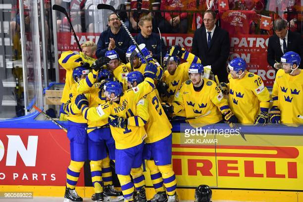 Sweden's players celebrate after scoring during the final match Sweden vs Switzerland of the 2018 IIHF Ice Hockey World Championship at the Royal...