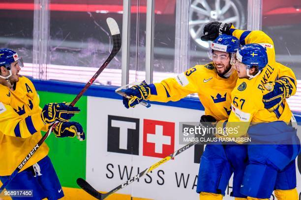 Sweden's players celebrate after scoring during the group A match Russia v Sweden of the 2018 IIHF Ice Hockey World Championship at the Royal Arena...