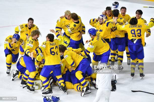 Sweden's players celebrate after the final match Sweden vs Switzerland of the 2018 IIHF Ice Hockey World Championship at the Royal Arena in...