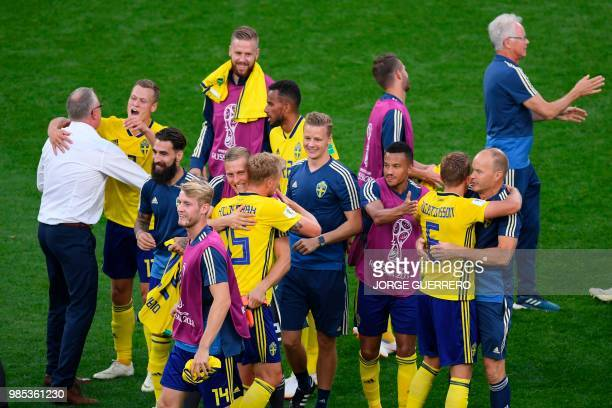Sweden's players celebrate after the Russia 2018 World Cup Group F football match between Mexico and Sweden at the Ekaterinburg Arena in Ekaterinburg...