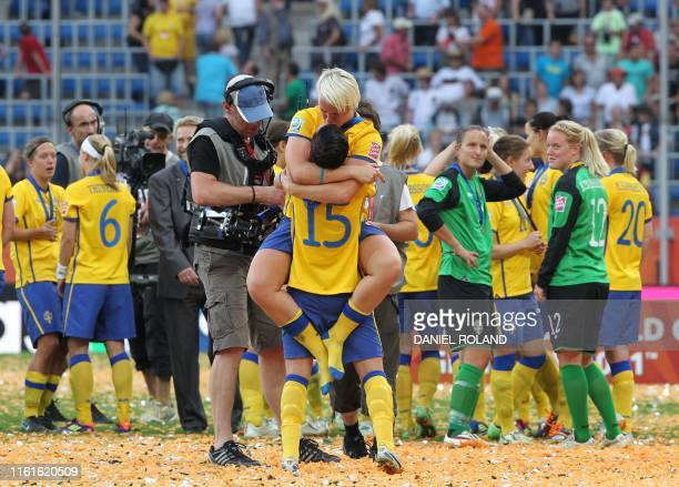 Sweden's players celebrate after the Sweden vs France FIFA women's football World Cup match for third place at the RheinNeckarArena in Sinsheim in...