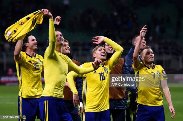 Sweden's players celebrate at the end of the FIFA World Cup 2018 qualification football match between Italy and Sweden on November 13 2017 at the San...