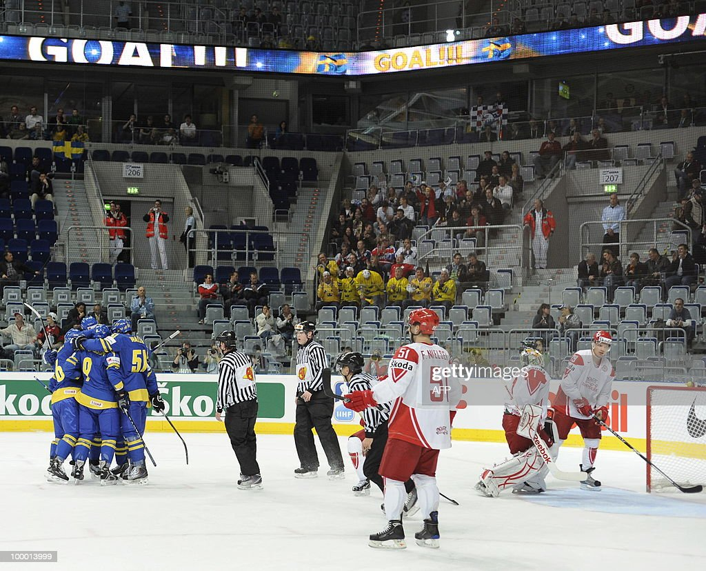Sweden's players celebrate scoring during the IIHF Ice Hockey World Championship quarter-final match Sweden vs Denmark in the southern German city of Mannheim on May 20, 2010. The 2010 IIHF Ice Hockey World Championships are taking place in Germany from May 7 to 23, 2010.