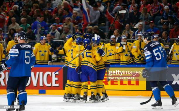 Sweden's players celebrate scoring the 2-1 goal during the IIHF Men's World Championship Ice Hockey semi-final match between Sweden and Finland in...