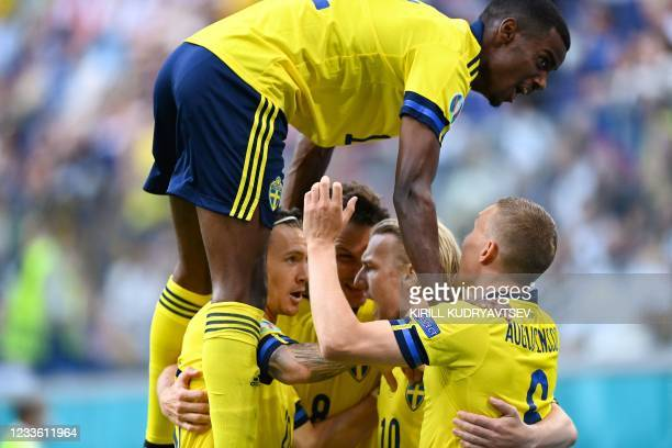 Sweden's players celebrate their first goal during the UEFA EURO 2020 Group E football match between Sweden and Poland at Saint Petersburg Stadium in...