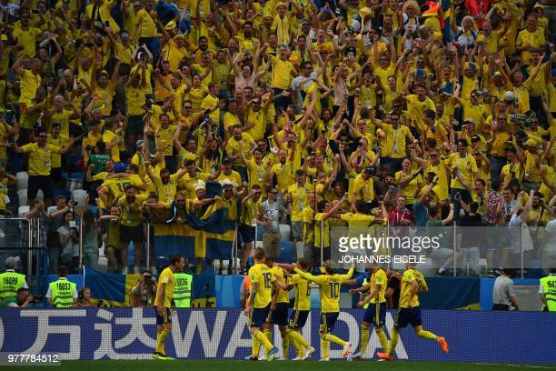 Sweden's players celebrate their opening goal during the Russia 2018 World Cup Group F football match between Sweden and South Korea at the Nizhny...