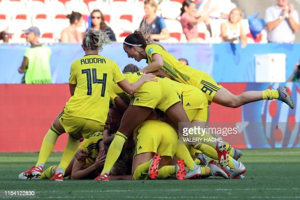 TOPSHOT Sweden's players celebrate their victory at the end of the France 2019 Women's World Cup third place final football match between England and...