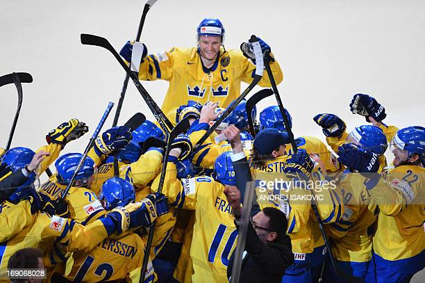 Sweden's players celebrate winning the final match Switzerland vs Sweden of the 2013 IIHF International Ice Hockey World Championship at Globe Arena...