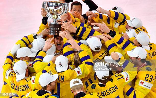 TOPSHOT Sweden's players celebrate with the trophy after the final match Sweden vs Switzerland of the 2018 IIHF Ice Hockey World Championship at the...