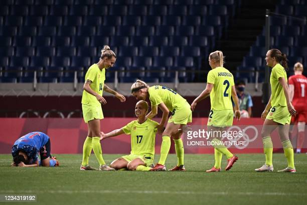 Sweden's players celebrates after winning the Tokyo 2020 Olympic Games women's quarter-final football match between Sweden and Japan at Saitama...