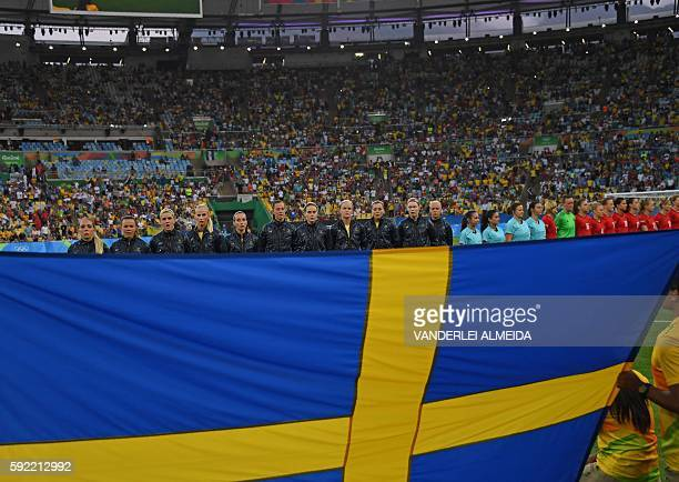Sweden's players listen to the national anthem prior to the Rio 2016 Olympic Games women's football Gold medal final match at the Maracana stadium in...