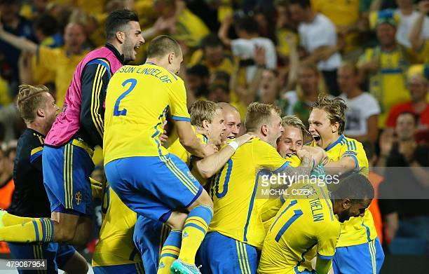 Sweden's players react after winning the UEFA Under 21 European Championship 2015 final football match between Sweden and Portugal in Prague on June...