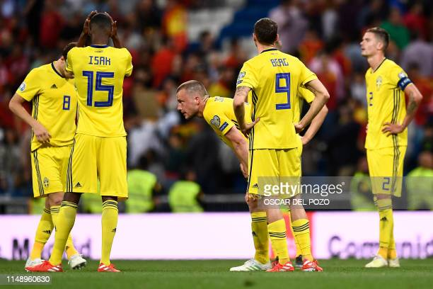 Sweden's players react to their defeat at the end of the UEFA Euro 2020 group F qualifying football match between Spain and Sweden at the Santiago...