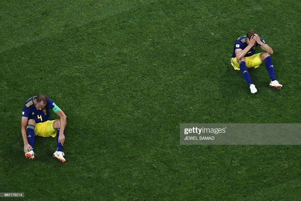 TOPSHOT - Sweden's players react to their loss during the Russia 2018 World Cup Group F football match between Germany and Sweden at the Fisht Stadium in Sochi on June 23, 2018. (Photo by Jewel SAMAD / AFP) / RESTRICTED