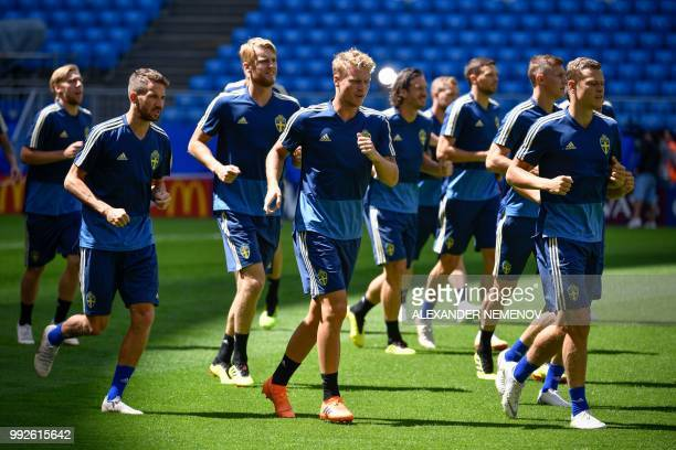 Sweden's players take part to a training session on the eve of the Russia 2018 FIFA World Cup quarter final football match between Sweden and England...