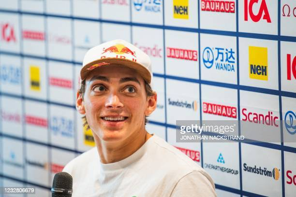 Sweden's pole vaulter Armand Duplantis looks up during a press conference in Stockholm, Sweden, on May 10 ahead of the Diamond League gala. - The...