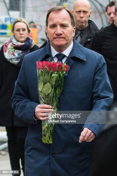 Sweden's Prime Minister Stefan Lofven visits the scene of a terrorist attack where a truck crashed after driving down a pedestrian street in downtown...