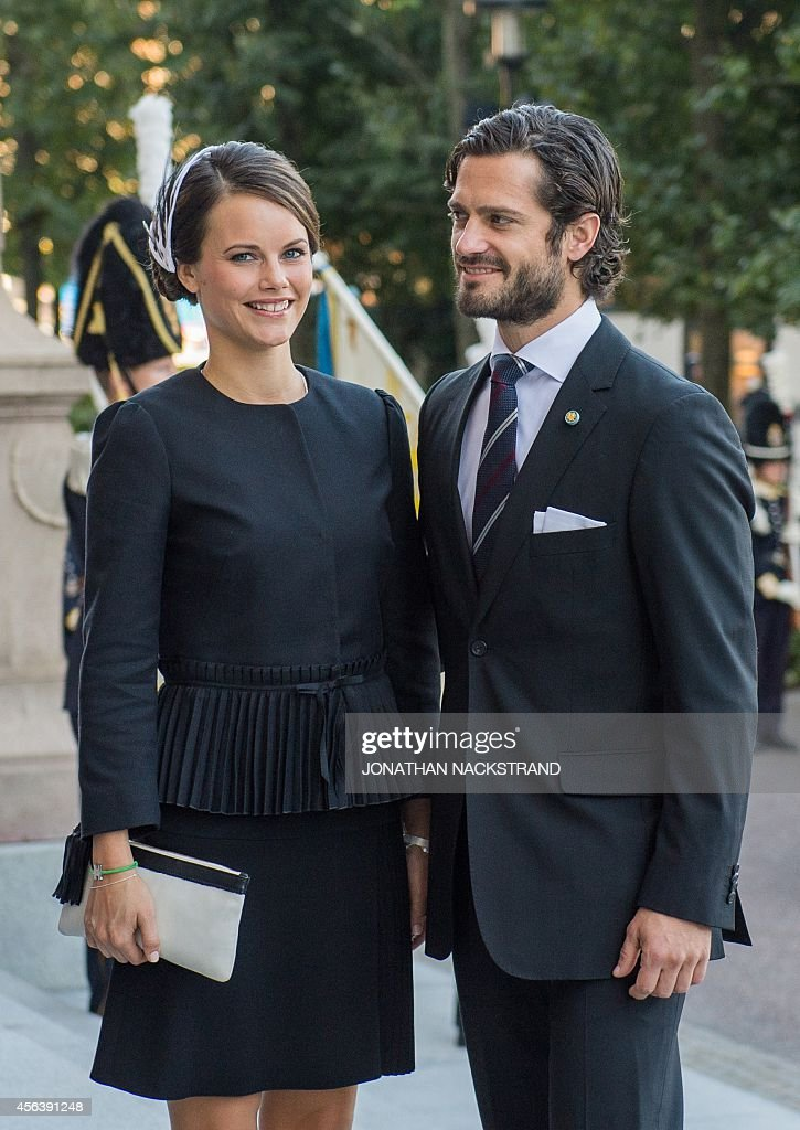 Sweden's Prince Carl Philip (R) and fiancee Miss Sofia Hellqvist arrive to attend the opening of the Swedish parliament in Stockholm on September 30, 2014.