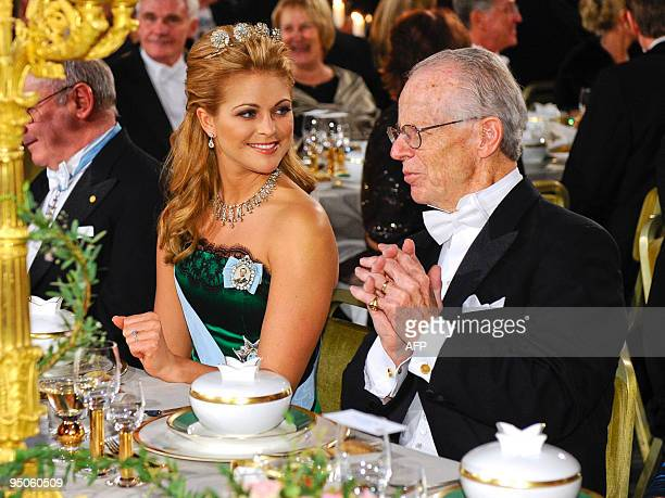 Sweden's Princess Madeleine sits with Nobel Economics laureate Oliver Williamson at the Nobel banquet in the Stockholm Town Hall on December 10 2009...