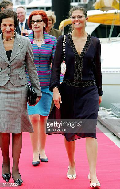 Sweden's Princess Victoria accompanied by New South Wales Governor Marie Bashir and other dignitaries walks down a red carpet after arriving at the...