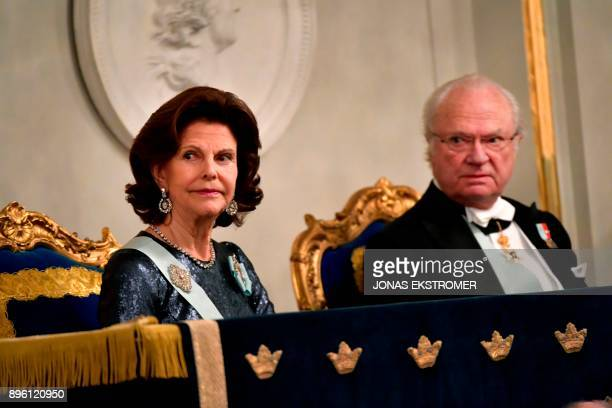 Sweden's Queen Silvia and King Carl Gustaf attend the Swedish Academy's annual meeting on December 20 2017 at the Old Stock Exchange building in...