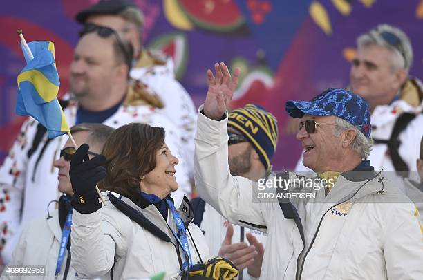 Sweden's Queen Silvia and King Carl Gustaf celebrate as Swedn's team wins the gold medal in the Men's CrossCountry Skiing 4 x 10km Relay at the Laura...