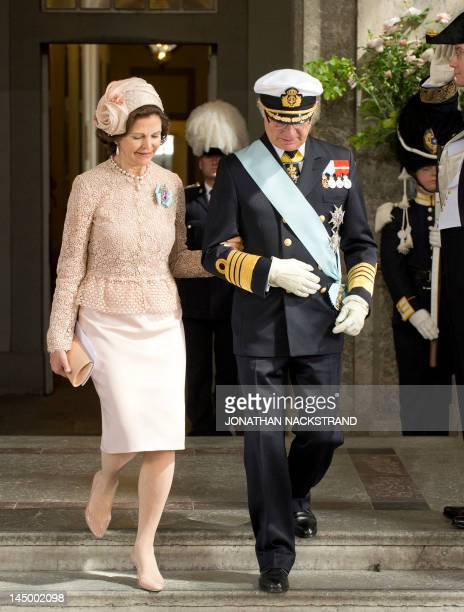 Sweden's Queen Silvia and King Carl Gustaf leave the Royal Chapel on May 22 2012 after the christening of Princess Estelle of Sweden in Stockholm...
