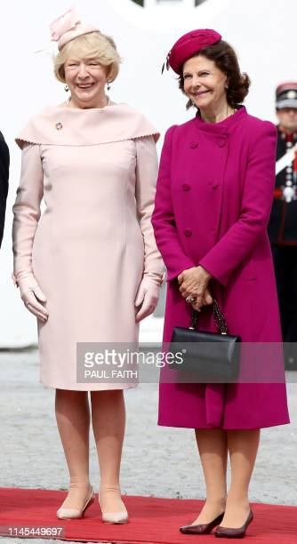 Sweden's Queen Silvia and Sabina Higgins, wife of Ireland's President Michael D Higgins pose for photogaphs at Pheonix Park in Dublin on May 22 on...