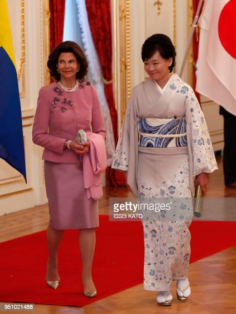 Sweden's Queen Silvia wife of Sweden's King Carl XVI Gustaf and Akie Abe wife of Japan's Prime Minister Shinzo Abe attend a welcoming ceremony at...