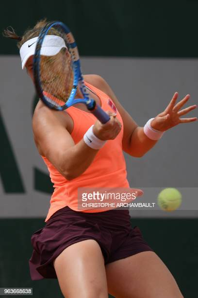 Sweden's Rebecca Peterson plays a forehand return to Romania's Mihaela Buzarnescu during their women's singles second round match on day four of The...
