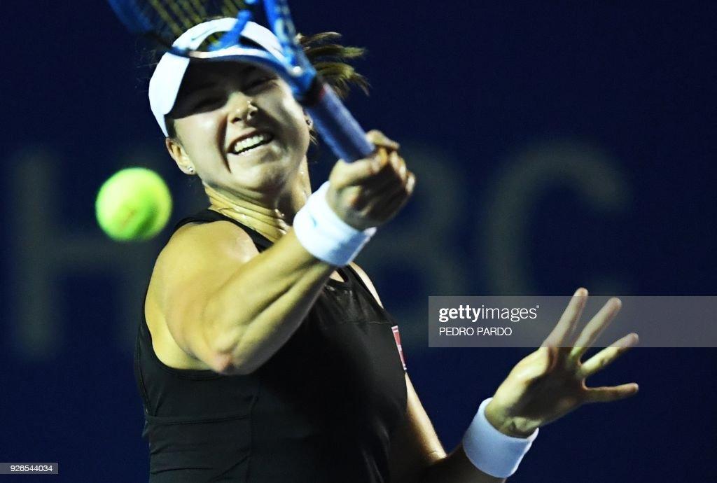 Sweden´s Rebecca Peterson returns the ball to Swiss Stefanie Voegele ...