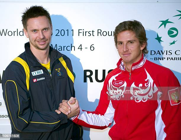 Sweden's Robin Soderling and Dmitry Tursunov, of Russia pose on March 3, 2011 after the draw ceremony Davis Cup first round match Sweden vs Russia in...