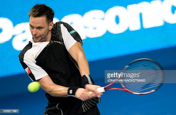Sweden's Robin Soderling returns the ball with a backhand shot to German's Benjamin Becker during the ATP Stockholm Open tennis tournament on October...