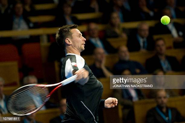 Sweden's Robin Soderling returns the ball with forehand shot to German's Benjamin Becker during the ATP Stockholm Open tennis tournament on October...