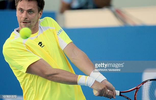 Sweden's Robin Soderling returns to his Swiss opponent Roger Federer during the first semifinal in the Mubadala World Tennis Champhionship in Abu...