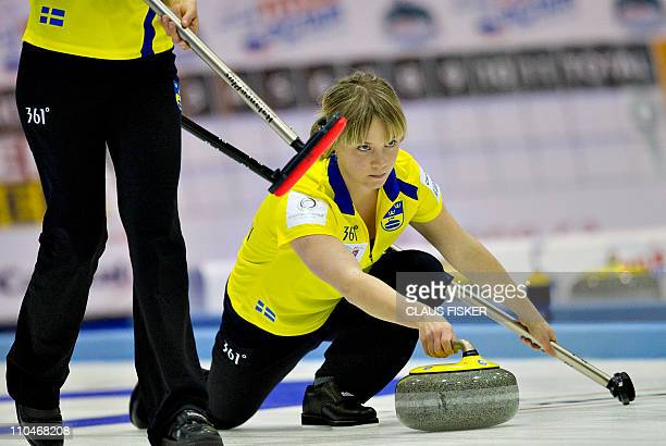 Sweden's Sara Carlsson keeps her eye on the line of her shot during play against Norway at the World Womens Curling Championships in Esbjerg, on...