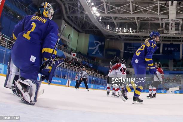 Sweden's Sara Grahn and Sweden's Maja Nylen Persson react as Japan's players celebrate teammate Japan's Ayaka Toko's goal in overtime in the women's...