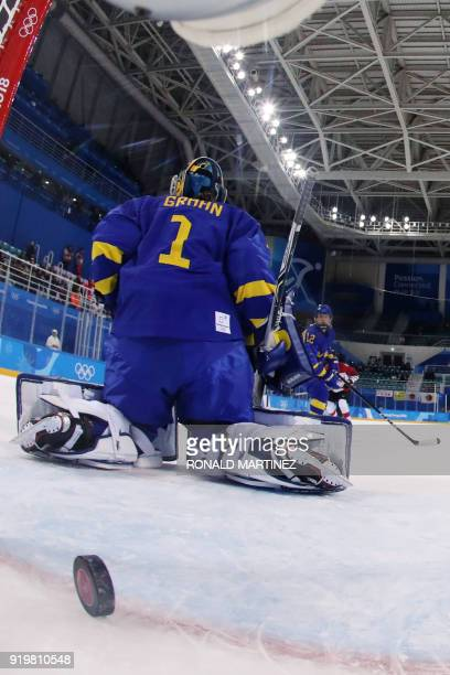 Sweden's Sara Grahn lets in the game winning goal by Japan's Ayaka Toko in overtime in the women's classifications ice hockey match between Sweden...