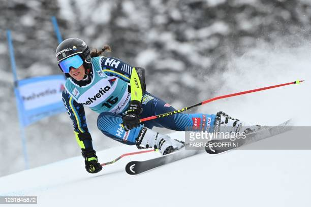 Sweden's Sara Hector competes in the first run of the Women's Giant Slalom event during the FIS Alpine ski World Cup in Lenzerheide, on March 21,...