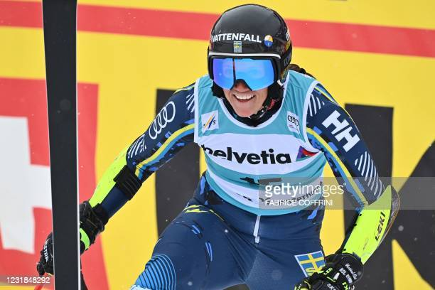 Sweden's Sara Hector reacts in the finishing area after competing in the second run of the Women's Giant Slalom event during the FIS Alpine ski World...