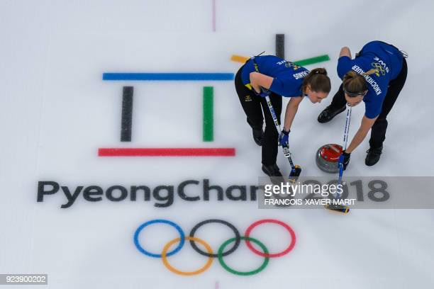 Sweden's Sara Mcmanus and Sweden's Agnes Knochenhauer compete during the curling women's gold medal game between South Korea and Sweden during the...