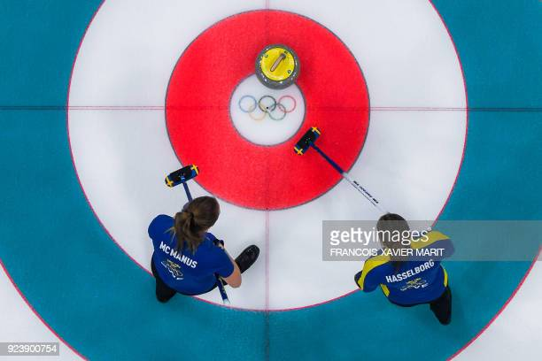 Sweden's Sara Mcmanus and Sweden's Anna Hasselborg compete during the curling women's gold medal game between South Korea and Sweden during the...